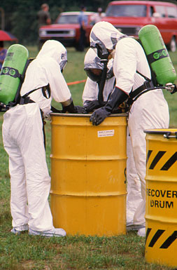 Fire and emergency response personnel practice techniques for hazardous materials containment and removal.